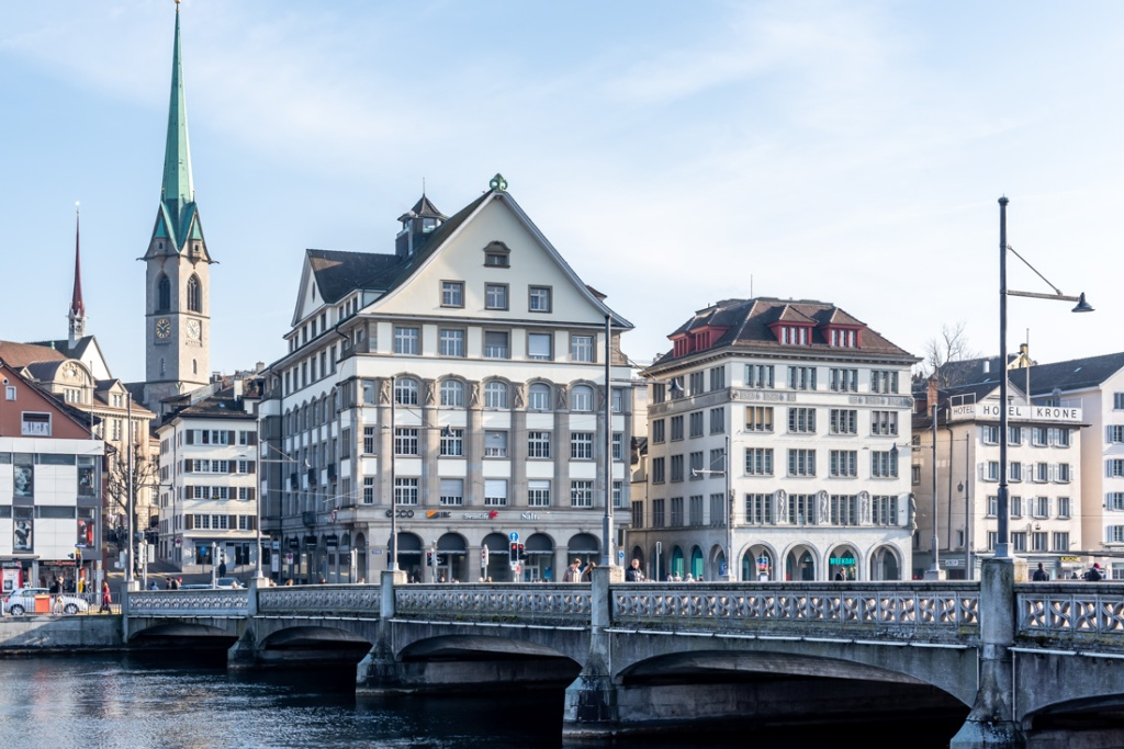 A bridge and historical buildings on the riverside in Zurich, Switzerland.