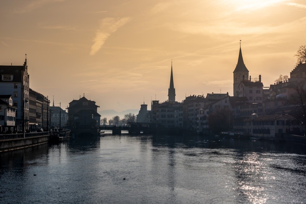 Sunset over the river and historic buildings in Zurich, Switzerland.